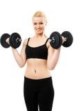 Jeune dame sportive établissant avec des poids Photos libres de droits