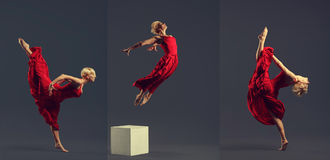 Jeune danseur classique magnifique portant la robe rouge au-dessus du Ba gris-foncé images stock