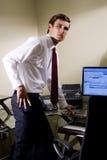 Jeune employé de bureau Photographie stock libre de droits
