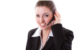 Jeune employé de centre d'appel avec un écouteur Photographie stock libre de droits