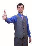 Jeune et respectable homme dans un costume gris L'homme montre la classe photo libre de droits