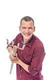 Jeune exploitant agricole gai avec une fourche sur un fond blanc Image libre de droits