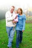 Jeune famille avec le bab Image stock