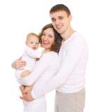 Jeune famille heureuse avec des sourires ouverts Photo stock
