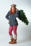 Jeune femelle avec un arbre de Noël Photographie stock