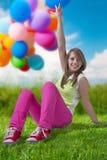 Adolescente heureuse avec des ballons Image stock