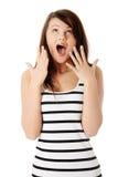 Jeune femme étonnée Photographie stock libre de droits
