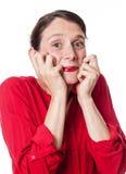Jeune femme étonnée souriant exprimant l'excitation photos stock