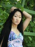 Jeune femme asiatique de portrait extérieure Photographie stock