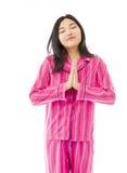 Jeune femme asiatique se tenant en position de prière Photographie stock