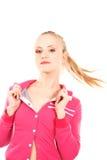 Jeune femme attirant dans le rose Photo libre de droits