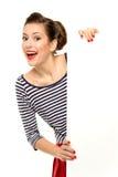 Jeune femme attirant retenant l'affiche blanc Photographie stock