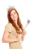 Jeune femme attirante retenant une baguette magique magique image libre de droits
