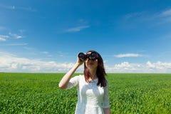 Jeune femme avec binoche Photographie stock