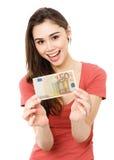 Jeune femme avec de l'argent Photographie stock libre de droits