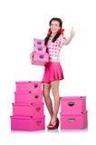 Jeune femme avec des boîtes de rangement Photographie stock libre de droits