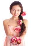 Jeune femme avec des fleurs Photographie stock