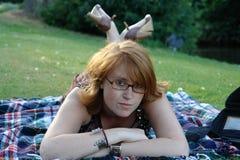 Jeune femme avec des glaces Photographie stock libre de droits