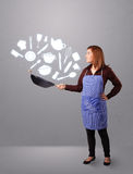 Jeune femme avec des icônes d'accessoires de cuisine Photos stock
