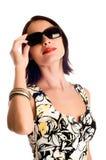 Jeune femme avec des lunettes de soleil Photo stock