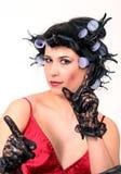 Jeune femme avec des rouleaux Image stock