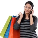 Jeune femme avec des sacs à provisions image stock
