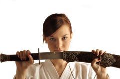 Jeune femme avec l'épée Photos stock