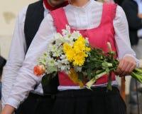 Jeune femme avec la fleur Photos stock