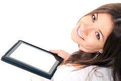Jeune femme avec la garniture de contact électronique neuve de tablette Image libre de droits