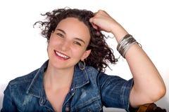 Jeune femme avec la main sur la tête Images libres de droits