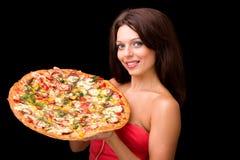 Jeune femme avec la pizza Photographie stock libre de droits
