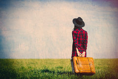 Jeune femme avec la valise Image stock