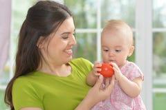 Jeune femme avec le bébé Photos libres de droits