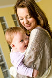 Jeune femme avec le bébé Photos stock