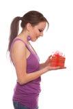 Jeune femme avec le cadre de cadeau Photos stock