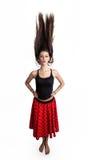 Jeune femme avec le cheveu circulant Photographie stock libre de droits