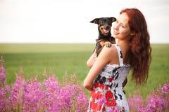 Fille avec un chien Photos libres de droits