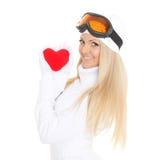 Jeune femme avec le coeur rouge dans des mains Images stock