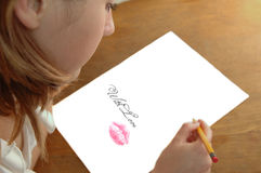 Jeune femme avec le crayon Photos stock