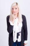 Jeune femme avec le doigt sur des languettes Photographie stock libre de droits