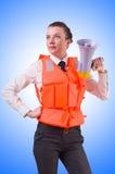 Jeune femme avec le gilet et le haut-parleur Photographie stock