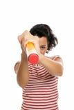 Jeune femme avec le grand caoutchouc de gomme à effacer de crayon d'isolement Images libres de droits