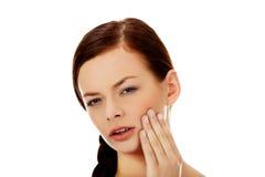 Jeune femme avec le mal de dent Photo libre de droits