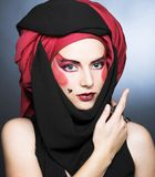 Jeune femme avec le maquillage créatif Photographie stock