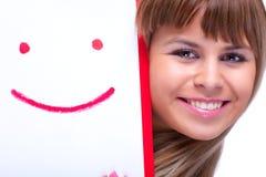 Jeune femme avec le symbole de sourire Photographie stock libre de droits