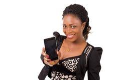 Jeune femme avec le téléphone portable Image stock