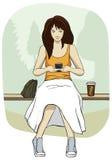 Jeune femme avec le téléphone portable Images libres de droits