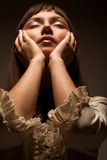Jeune femme avec les yeux fermés Photos libres de droits