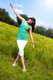 Jeune femme avec un beau sourire Photographie stock libre de droits