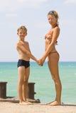 Jeune femme avec un fils Photos stock
